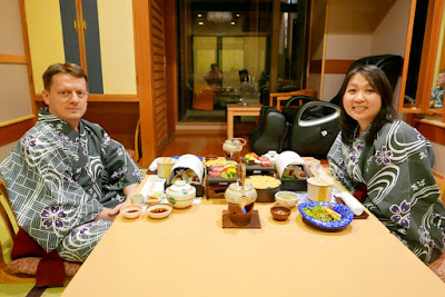 Dining at a Ryokan: Traditional Dinner in our room at our ryokan Wakakusa no Yado Maruei, photo she took from the sliding door to our traditional tatami mat room