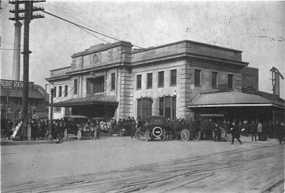 The second depot building in Madison for the Chicago & Northwestern Railway. The building was touted by the newspapers as the most beautiful depot in the Northwestern system, when it was built in 1910, designed by the architectural firm of Frost and Granger of Chicago. Refer to the story on page 263 of David Mollenhoff's book, Madison: A History of the Formative Years, University of Wisconsin Press, Madison, 2003.Courtesy of Gary TiplerDate: c.1920