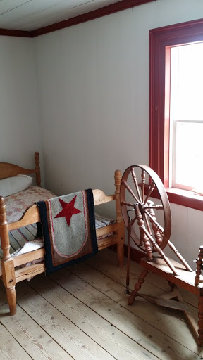 See that red star? That's a symbol of Acadia! From Acadian History Comes Alive in a New Brunswick Village