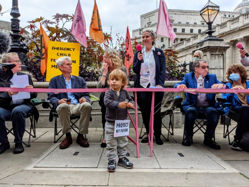 An 'Emergency Child Protection Meeting' at the pink tables