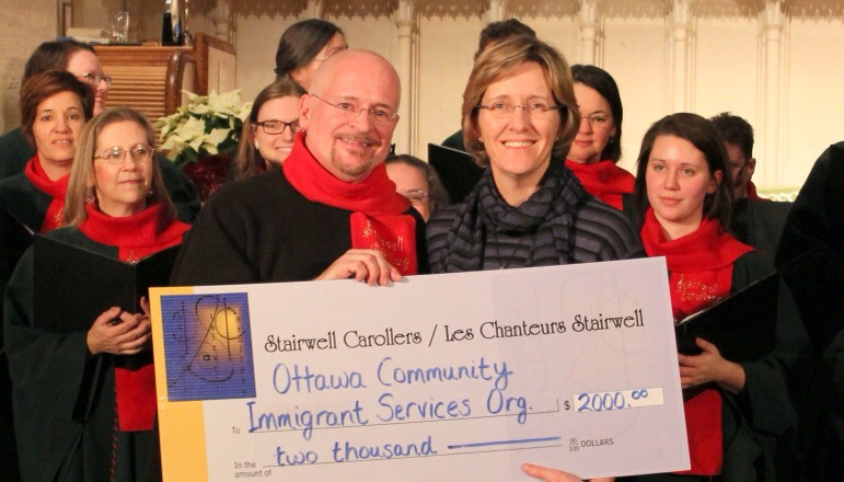 Stairwell Carollers present $2000 to Ottawa Immigrant Services