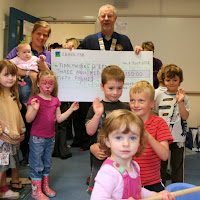 July 2012.  Presentation of cheque for £350 to Tiddlywinks Nursery, BoA, to provide a sand pit.