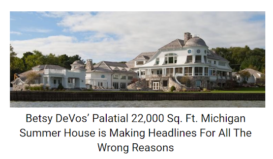 Photo of an enormous mansion, caption; Betsy DeVos' Palatial 22,000 Sq. Ft. Michigan Summer House is Making Headlines For All The Wrong Reasons
