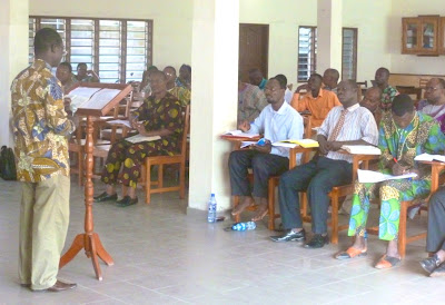 Local Facilitator Giving A Bible Exposition