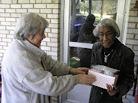 Volunteer delivering meal