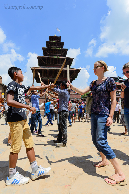 A foreigner participates in the stick dance