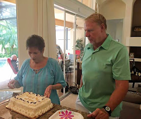 Jerry and Peg admiring the beautiful cake presented to them
