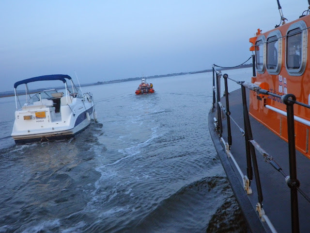 The ALB escorts the motor cruiser which is under tow by the ILB - 31 October 2014. Photo credit: Dave Riley