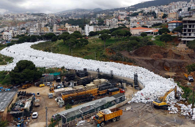 A river of white-bagged garbage winds through Beirut, Lebanon. Photo: Joseph Eid / AFP / Getty Images