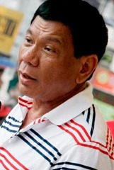 Davao City Mayor Rodrigo Duterte speaks before the protesting residents in the city who are calling for the moratorium on housing foreclosure in several housing projects in the city. At least 5,000 homeowners coming from different subdivisions in the city and even from neighboring towns and cities marched around the city on Wednesday afternoon, Feburary 11, 2008 to oppose the transfer of an estimated P13 billion worth of housing loans with the National Home Mortgage Finance Corporation (NHMFC) to a private entity known as Balikatan Housing Finance Inc. (BHFI). AKP Images / Keith Bacongco
