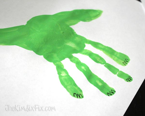 Painted dinosaur from handprint