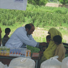 Pictures of Free Medical Camp & Distribution of Flour & Cloth at Kot Peer Sadat Lodhran