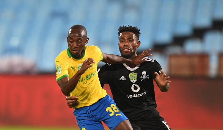 Peter Shalulile of Mamelodi Sundowns is challenged by Thulani Hlatshwayo of Orlando Pirates at Loftus Versfeld on Thursday. Picture: SYDNEY MAHLANGU/BACKPAGEPIX