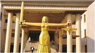 FASHION DESIGNER BLAMES ABUSE OF NEIGHBOUR'S FOUR-YEAR-OLD DAUGHTER ON DEVIL