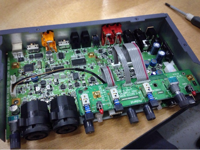 The insides of a USB audio interface with a recently replaced power switch.