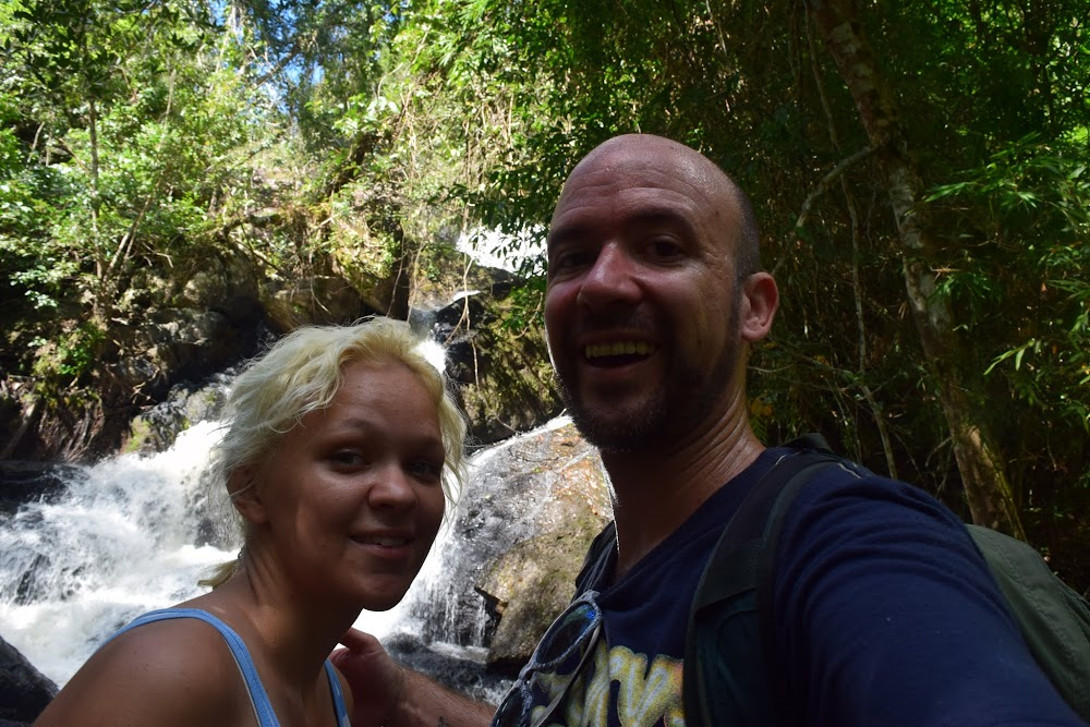 Before long, we make it to the Pha Kluai Mai waterfall, only 1km down the trail.  It's alright but not real special, and no spots to swim.  We take a snack break there and admire the jungle waterfall, while fish nibble at our feet sticking in the water...