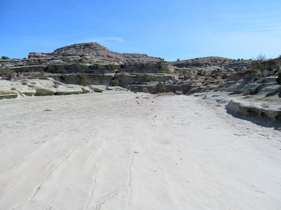 Broad, flat Curtis Formation sandstone wash bottom