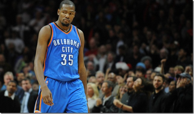 December 21, 2015; Los Angeles, CA, USA; Oklahoma City Thunder forward Kevin Durant (35) reacts after scoring a basket against Los Angeles Clippers during the second half  at Staples Center. Mandatory Credit: Gary A. Vasquez-USA TODAY Sports