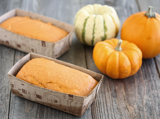 photo of two pumpkin cakes in paper loaf pans