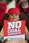 Four-year-old Paula Dave from The Dalles, Ore., holds a sign during the first of three public hearings at the Cowlitz County Regional Event Center in Longview, Wash., on May 24, 2016, concerning the proposed Millennium Bulk Terminals coal export terminal. (Photo by: Alex Milan Tracy)