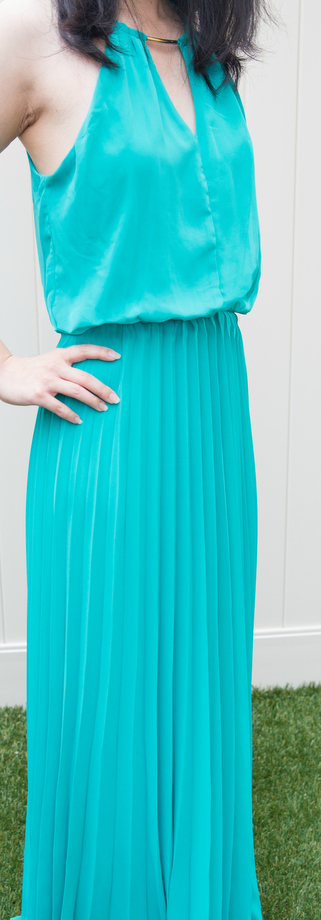 photo of a woman wearing a long turquoise dress