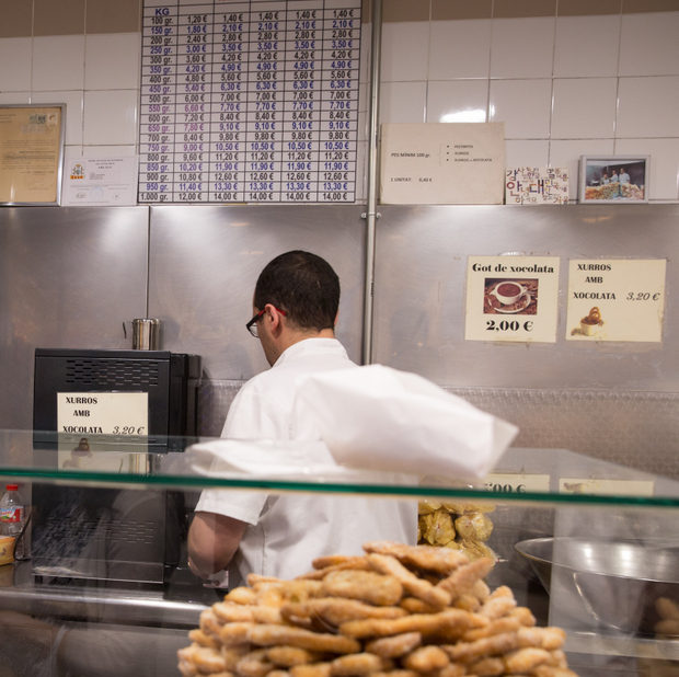 photo of an employee making churros