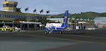 Winair still uses the old terminal at St. Maarten.  Seen here awaiting pax for Beef Island
