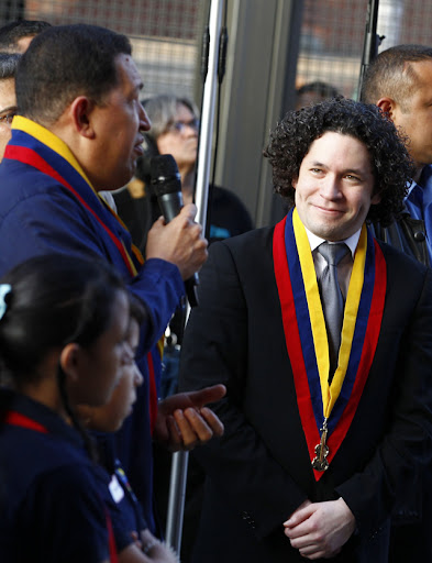Maestro Dudamel and Presidente Chávez at the El Sistema's 36th anniversary ceremony. Reuters photo.