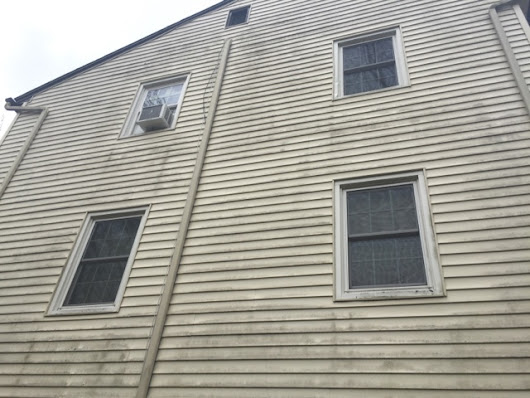 Power washing vinyl sided house in Bethel