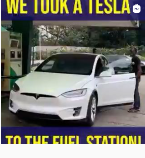 Fuel attendants try to locate the ''fuel tank'' of a Tesla car after its owner brought it in for a test (video)