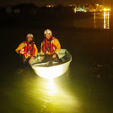 Poole ILB crew members retrieve a drifting dinghy just before midnight on 19 August 2013. Photo: RNLI/Poole