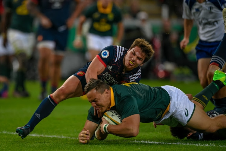 Springbok and Sharks tighthead prop Coenie Oosthuizen scores a try during the 2nd Castle Lager Incoming Series Test match between South Africa and France at Growthpoint Kings Park on June 17, 2017 in Durban, South Africa.