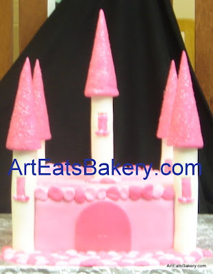 3D fondant pink and white princess castle girl's birthday cake