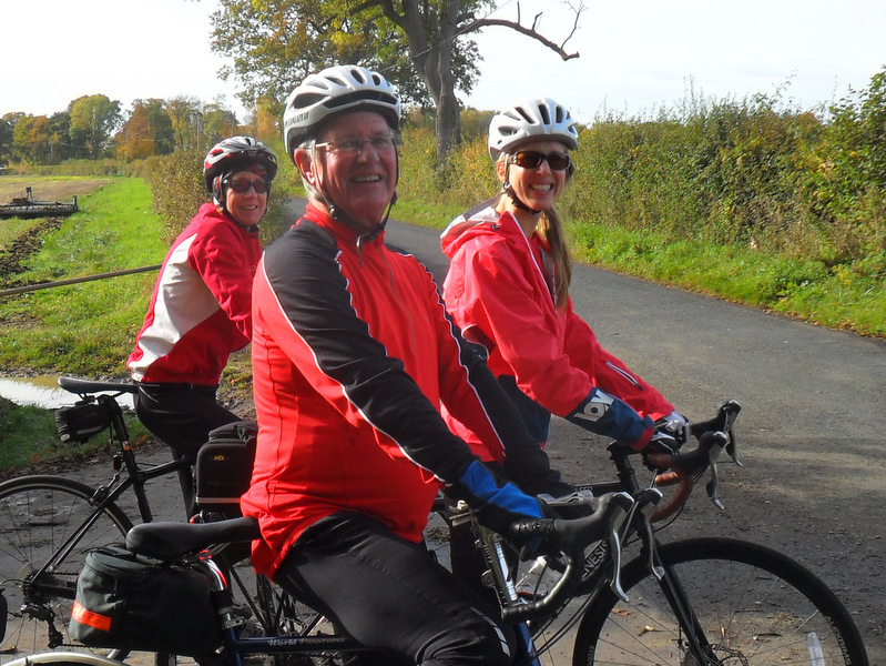 3 cyclists in red jackets