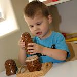 Preschool Montessori boy exploring through sensorial development.