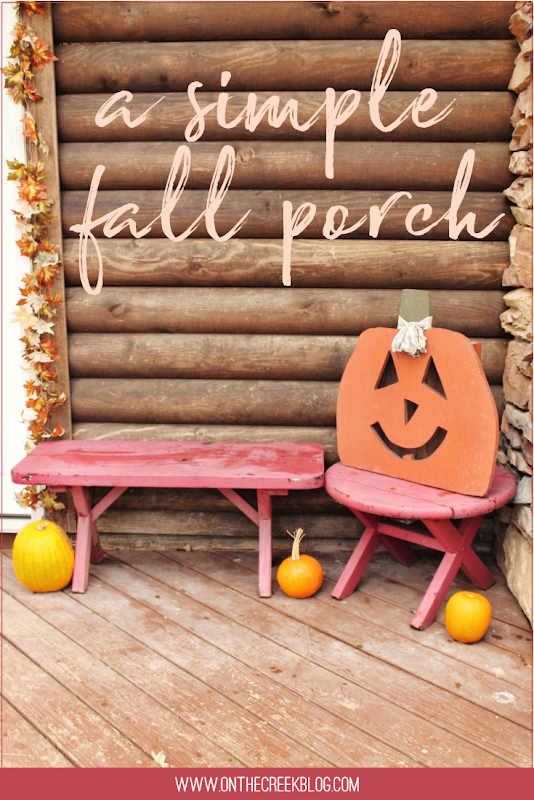 Super simple fall front porch using yard sale finds including a large wooden pumpkin!