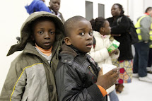 Refugees arrive from a flight from Libya at the Pratica di Mare Military airport in Rome February 24, 2011. Governments around the world scrambled on Wednesday to send planes and ships to evacuate their citizens from turmoil in Libya, whose leader Muammar