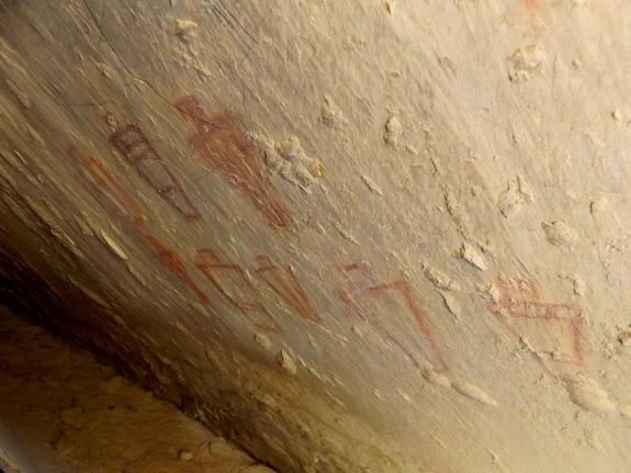 Fremont pictographs behind a slab of rock