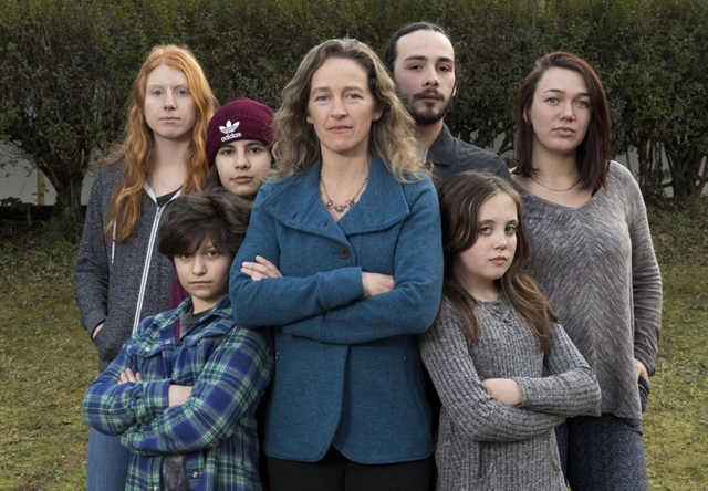Avery McRae, bottom right, is part of a group of young people claiming the federal government has knowingly endangered them by promoting the burning of fossil fuels. Photo: Robin Loznak