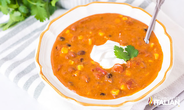 a bowl of chili soup on the table