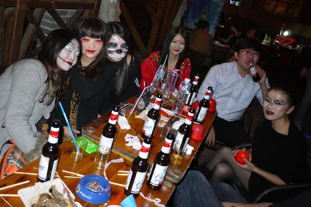 several people drinking while dressed up for Halloween in Changsha, China