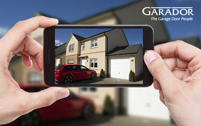 Image of smartphone photographing Garador garage door