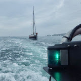 Starboard-side shot of the 8m yacht under tow - 23 July 2013. Photo credit: RNLI/Poole