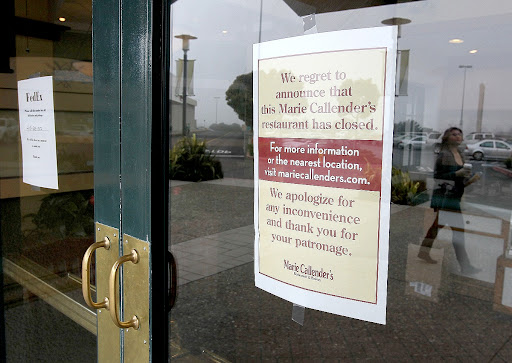 DALY CITY, CA - JUNE 13:  A sign displayed on a door announces the closure of a Marie Callender's Restaurant and Bakery on June 13, 2011 in Daly City, California.  Memphis based Perkins & Marie Callender's Inc. has filed for Chapter 11 bankruptcy protection and has shut down several restaurants and they begin a massive financial restructuring campaign. (Photo by Justin Sullivan/Getty Images) 115978684