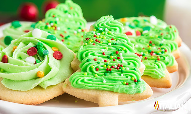 sugar cookie frosting on a plate of cookies