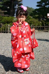 Little girl in traditional dress at Zenko-ji Temple