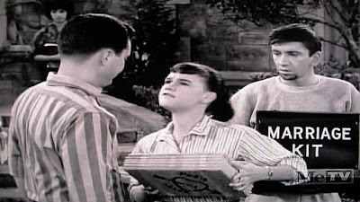Marriage kit held by Maynard behind Zelda talking about marriage to Dobbie Gillis in 1962 TV sitcom