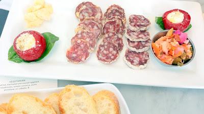 Charcuterie Plate with cured meats, parm, pickeld veg, baguette