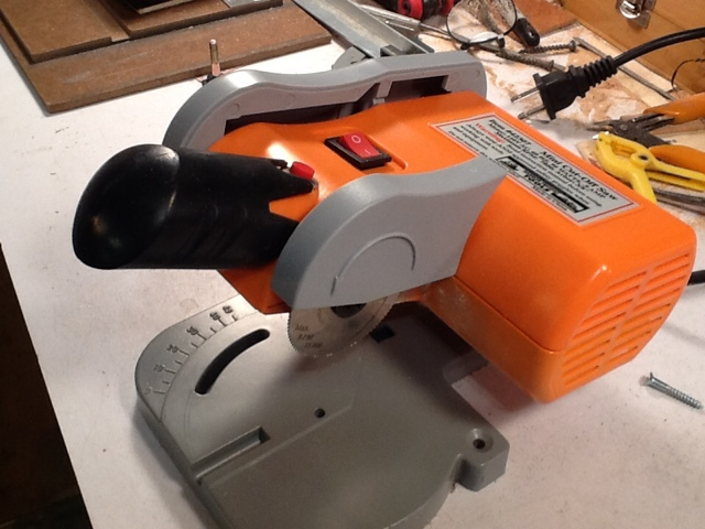 Madness in miniatures harbor freight chopmiter saw modifications next using a small allen wrench that will fit through the hole underneath remove the blade the allen wrench is to keep the shaft from turning and fits greentooth Choice Image