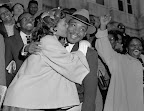 MLK and Wife - Montgomery Bus Boycott Rev. Martin Luther King, Jr., is welcomed with a kiss by his wife Coretta after leaving the Montgomery court March 22, 1956. King was found guilty of conspiracy to boycott city buses in a campaign to desegregate the bus system, but a judge suspended his $500 fine pending appeal. (AP/Wide World Photos)